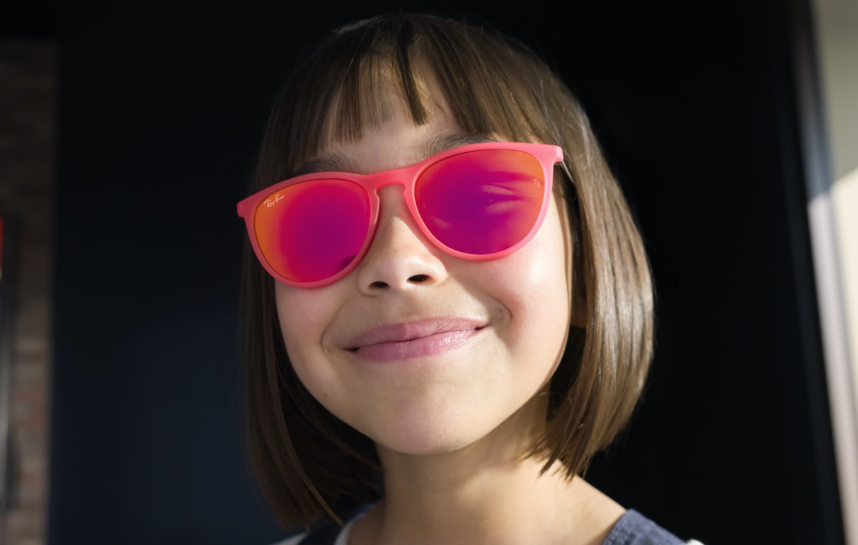 a kid with sunglesses image